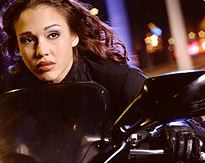 Max on her motorcycle